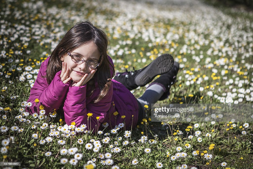 Girl in the field with flowers : Foto stock