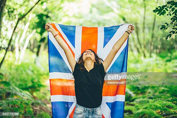 Girl in the forest with an English Flag