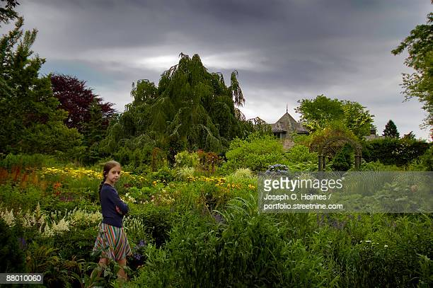 girl in the garden - joseph o. holmes stock pictures, royalty-free photos & images