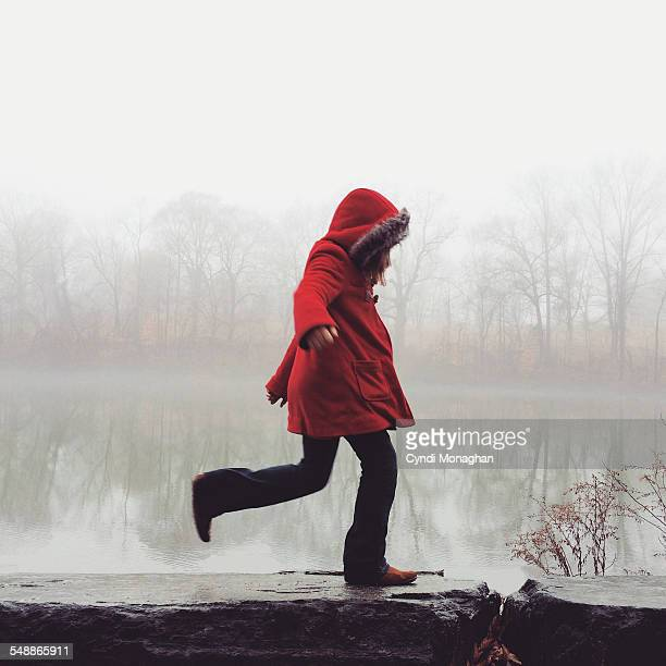 girl in the mist - winter coat stock pictures, royalty-free photos & images