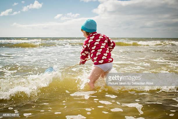 girl in the north sea - junge in unterhose stock-fotos und bilder