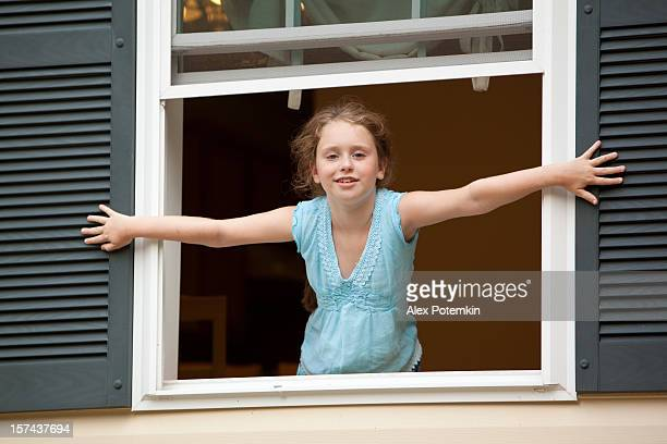 Girl in the open window