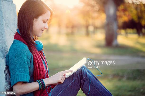 Girl in the park using tablet