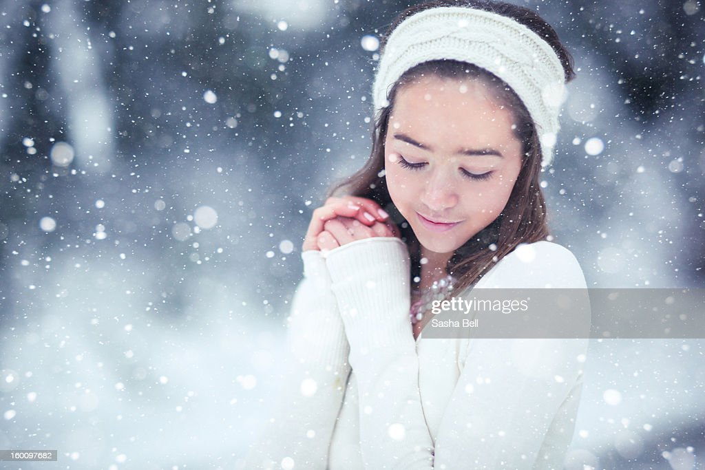 Girl in the snow wearing cream headband : Stock Photo