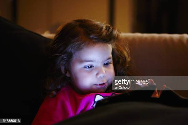 Girl in the sofa using a digital tablet