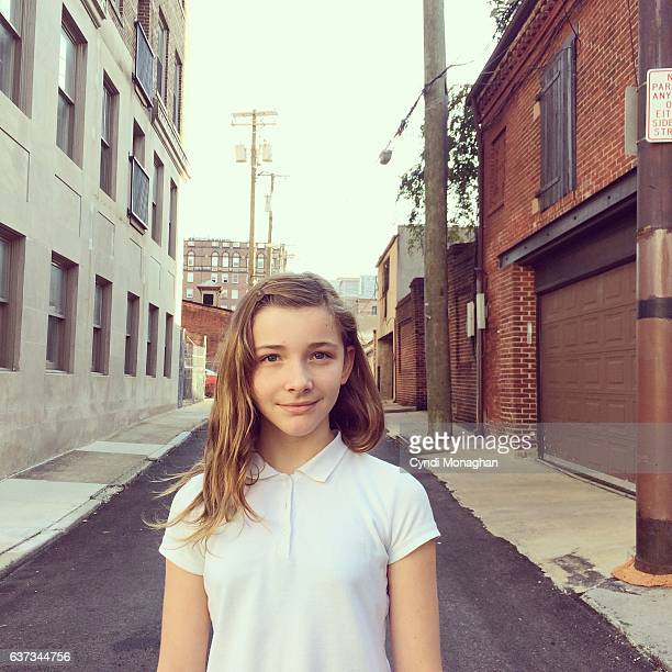 girl in the street - budding tween stock photos and pictures