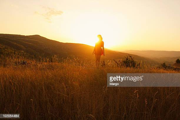 girl in the sunset of a valley - aveyron stock pictures, royalty-free photos & images