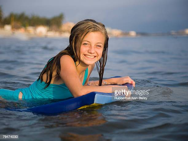 Girl in the water with surfboard