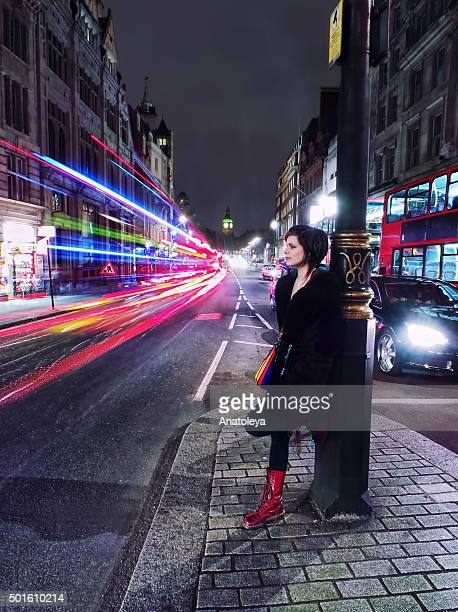 girl in traffic on whitehall at night - anatoleya stock pictures, royalty-free photos & images