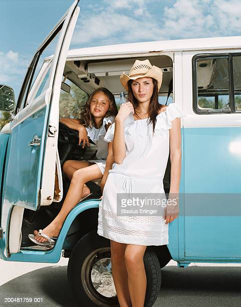 girl (7-9) in van driver's seat, woman standing in front - blasius erlinger stock pictures, royalty-free photos & images