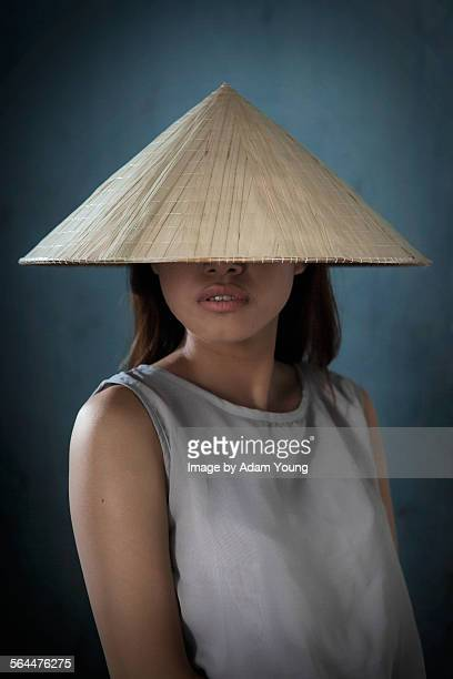 Girl in Vietnam with traditional non la hat