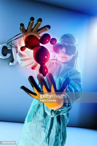 Girl in virtual reality headset interacting with digital floating blood globules
