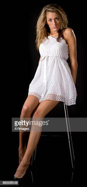 Legs And Short Skirt Sitting Down Stock Photos And