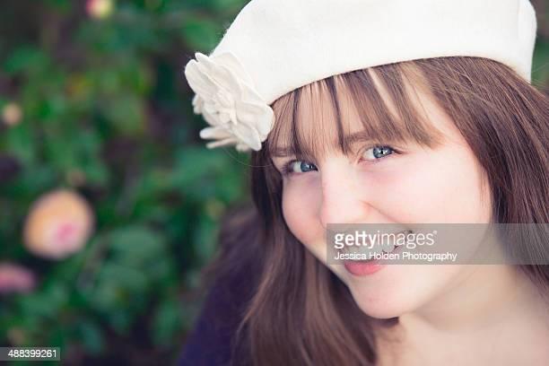 Girl in white felt Bberet