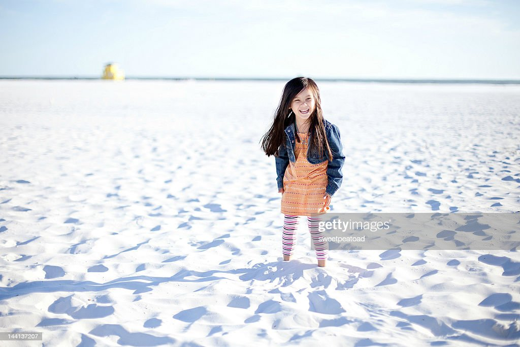 Girl in white sand in siesta key : Stock Photo
