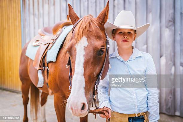 Girl in wild west riding outfit together with her horse