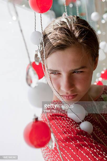 Girl in Window with (Christmas) Decorations