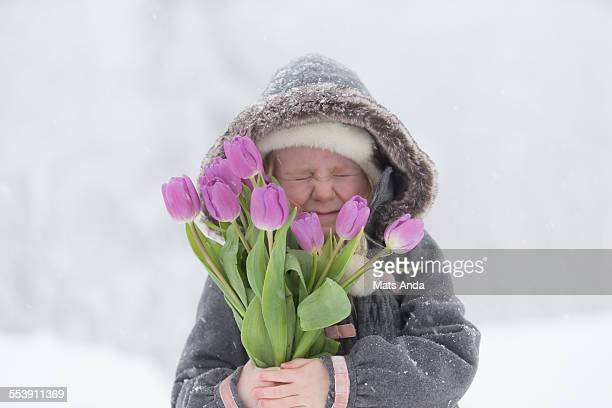 Girl in winter scene with flowers