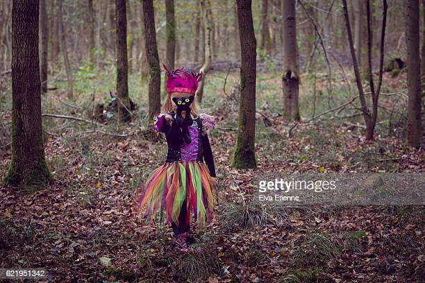 Girl in witch costume, alone in the woods
