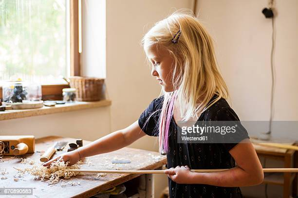 girl in workshop working on stone-age spear-thrower - carving craft product imagens e fotografias de stock