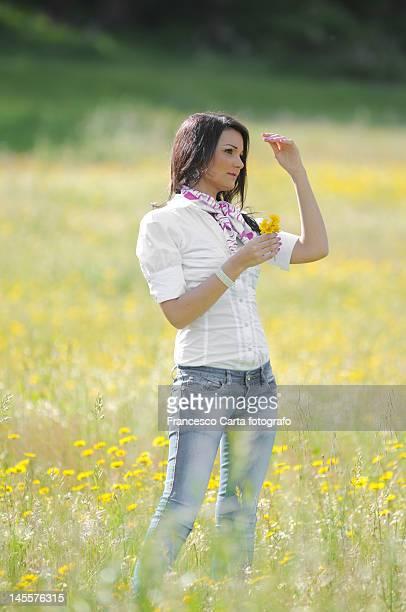 Girl in yellow daisy field