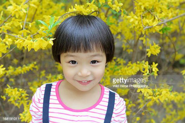 A girl in yellow flowers