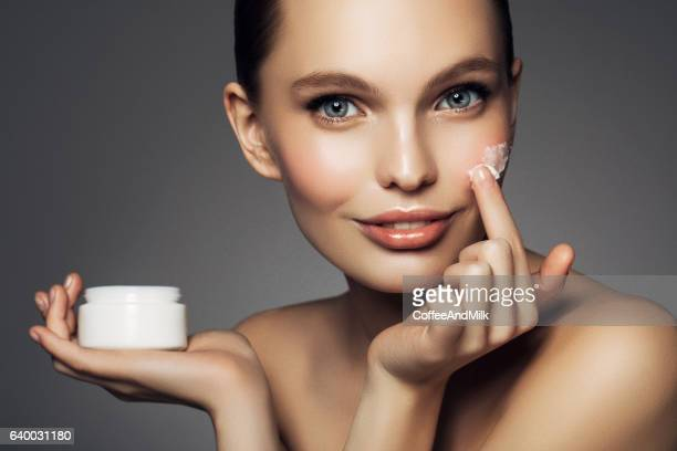 girl inflicting cream - stage make up stock photos and pictures