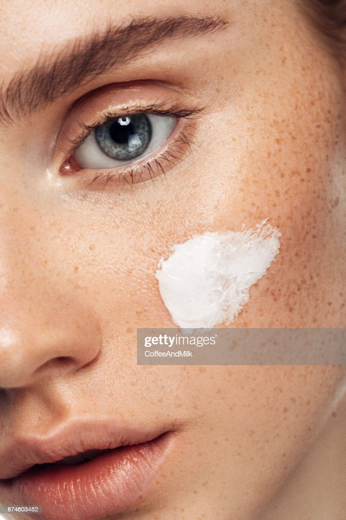 Girl inflicting cream : Stock Photo
