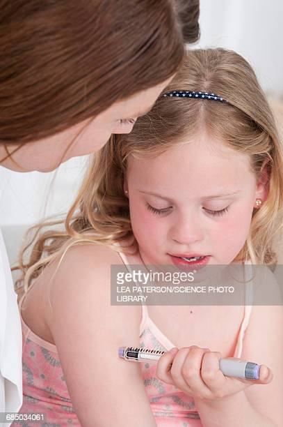 Girl injecting herself in arm