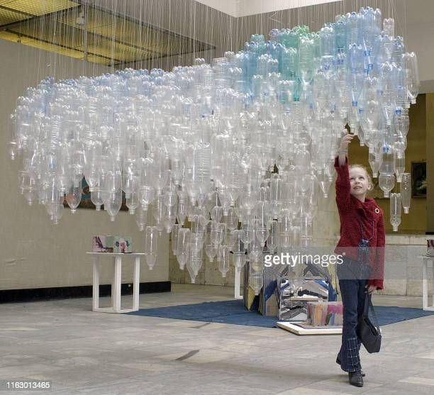 A girl inspects a sculpture of a mammoth created by a group of Finnish artists from 700 bottles collected by them in cafes in Saint Petersburg 24...