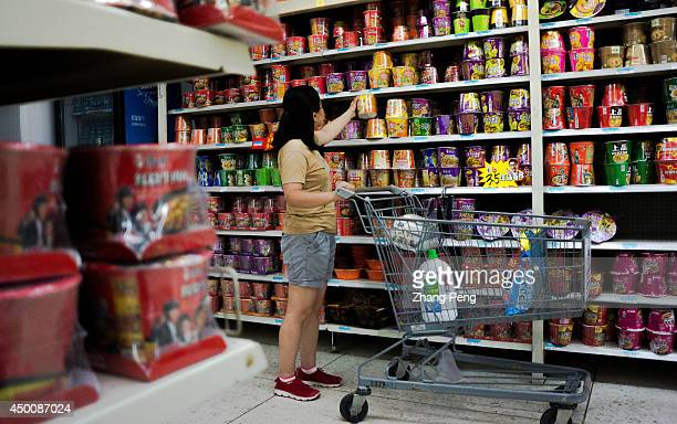 A girl is choosing instant noodles in a WalMart store American retailer WalMart Stores Inc has appointed Sean Clarke as new chief executive for the...