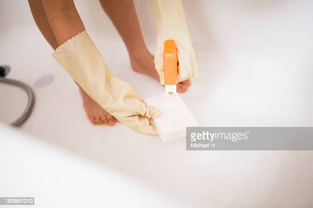 a girl is cleaning bathtub - kids with cleaning rubber gloves stock pictures, royalty-free photos & images