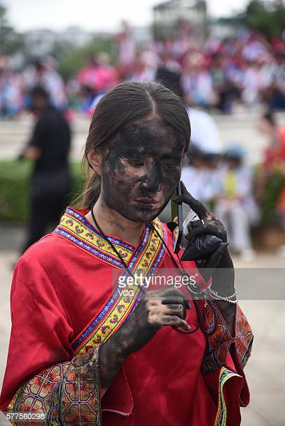 A girl is daubed rice ash on face during the Face Painting Festival in Puzhehei Resort of Qiubei County on July 18 2016 in Wenshan Prefecture Yunnan...