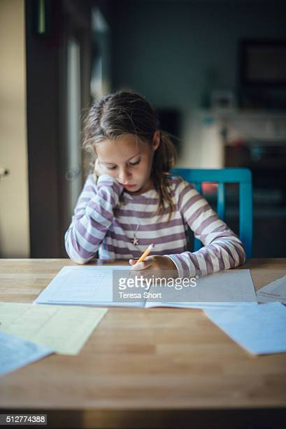 Girl is doing homework at a table