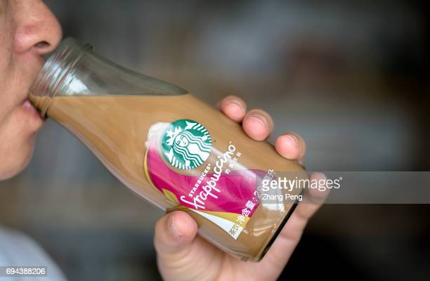 A girl is drinking a black tea taste of Starbucks bottled Frappuccino In the first quarter of 2017 targeting to the Chinese consumers Starbucks...
