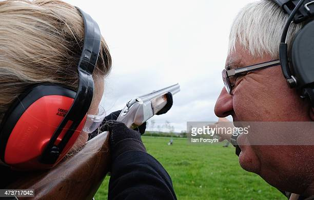 A girl is given tuition at a clay pigeon shooting stand at the Pickering Game and Country fair on May 17 2015 in Pickering England Set in acres of...