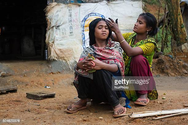 A girl is helping another girl with taking care of her hair inside stone workers' villageon April 4 2015 in Jaflong Sylhet Bangladesh Stone workers...