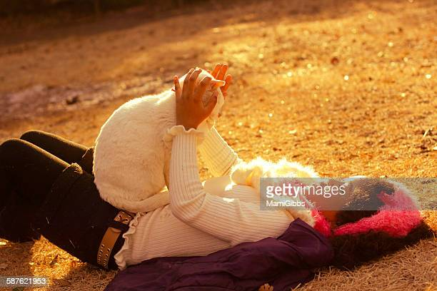 girl is holding cat on the sunset park - mamigibbs stock photos and pictures