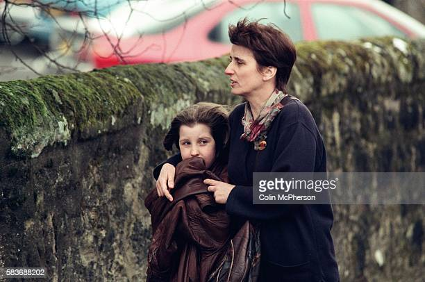 A girl is led away by an adult outside Dunblane primary school Scotland shortly after the shooting incident on the premises The Dunblane school...