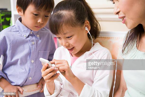 A girl is listening music by Smartphone