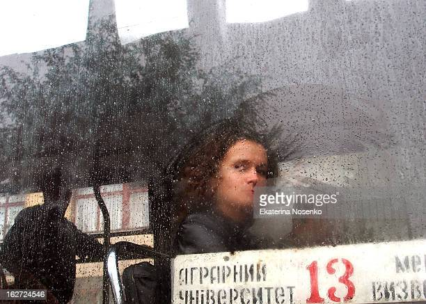 CONTENT] A girl is looking through the steamed window of a trolleybus on a rainy day in a provincial Ukrainian city Vinnitsa Ukraine August 2012