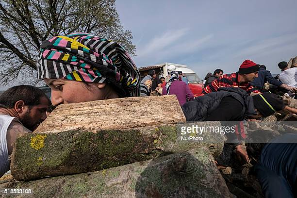 A girl is moving fire wood to her tent in Idomeni Greece on 1st April 2016 The life in the camp is getting harder and harder especially now that the...
