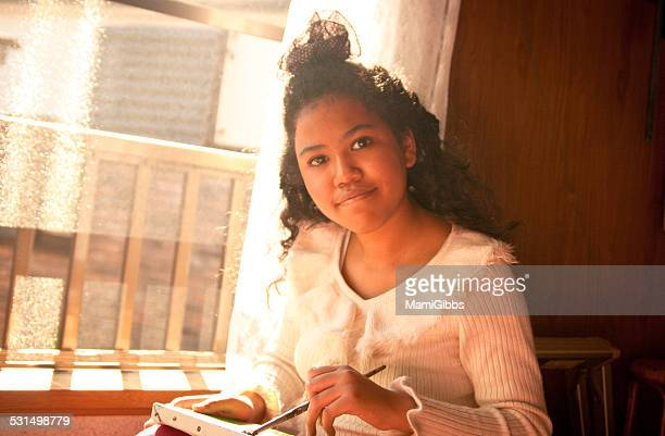 girl is painting in the sunset light - mamigibbs stock photos and pictures