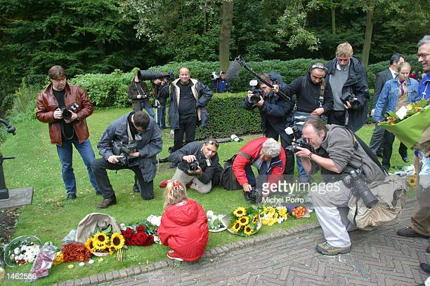 A girl is photographed by the media as she lays flowers at Royal palace the 'Huis ten Bosch' in The Hague The Netherlands October 7 2002 Prince Claus...