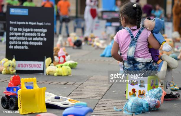 A girl is pictured during an urban intervention at Bolivar square in Bogota to protest against child abuse and to raise awareness on children's...