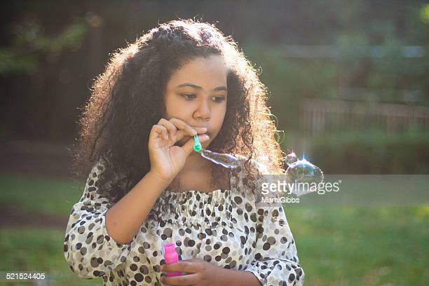 girl is playing bubble - mamigibbs stock photos and pictures