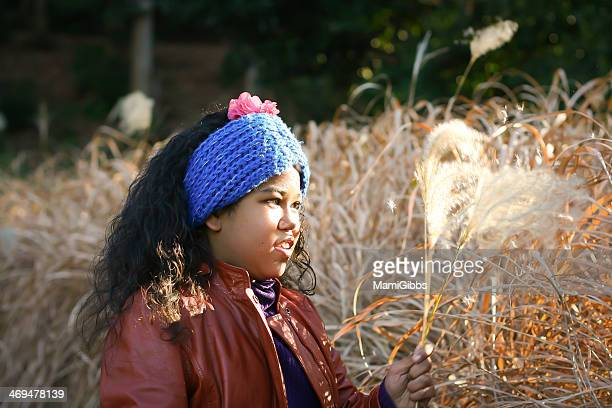 girl is playing the silver grass. - mamigibbs stock photos and pictures