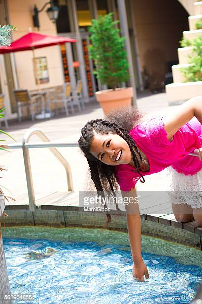 girl is playing water - mamigibbs stock photos and pictures