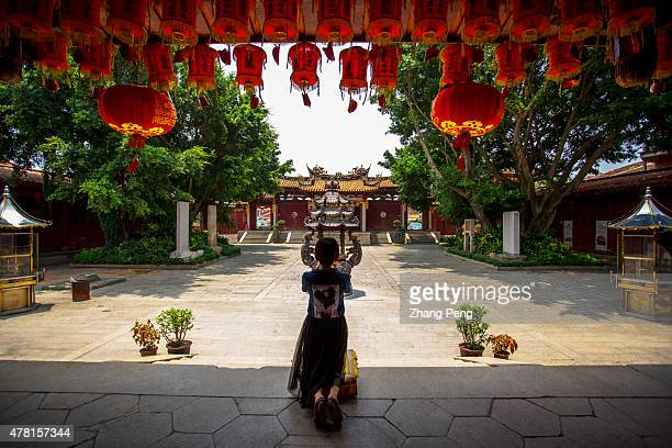 A girl is praying in front of the main hall The Heavenly Empress Palace in Quanzhou constructed in 1196 during Song Dynasty is the earliest AMa...
