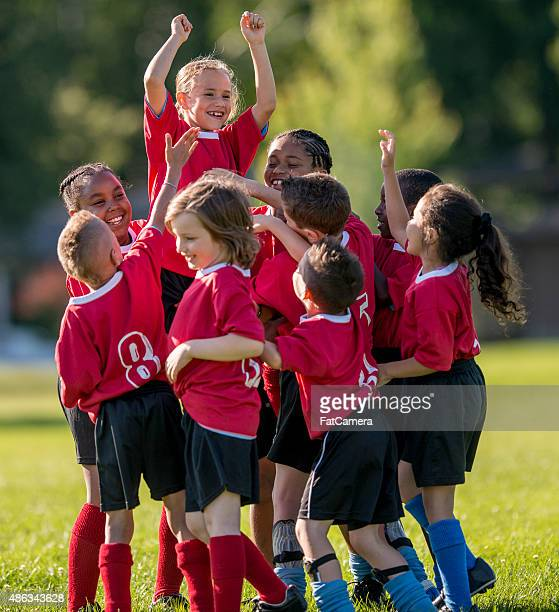 Girl is Raised Up by Teammates
